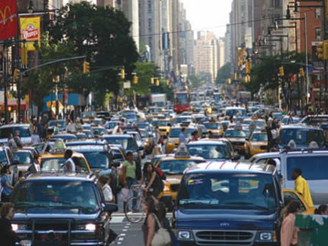 photo of a traffic jam, many people out of their vehicles, a downtown scene