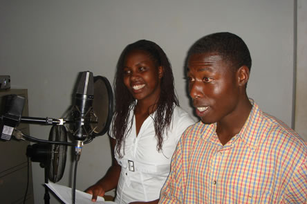 photo of young people using recording equipment, scripts evident