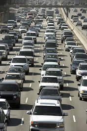 photo of cars on a freeway, crowded together