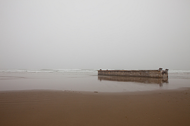 photo of an expanse of sand, an enigmatic ruin thereupon