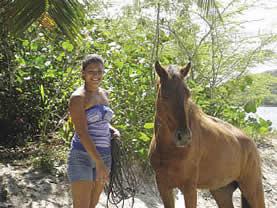 photo of a young woman with a horse