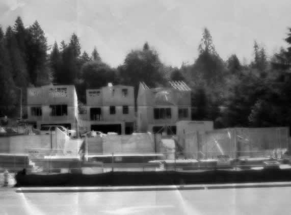 antiqued photo of a set of homes under construction - no activity is evident
