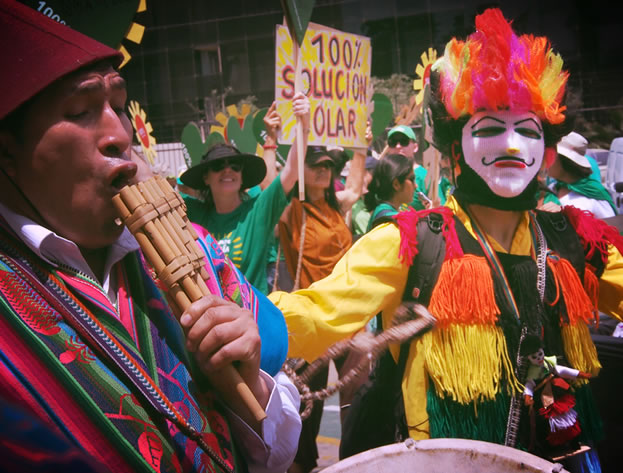 photo of demonstrators in colorful costumes