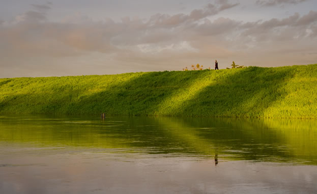 photo of a levee by a river