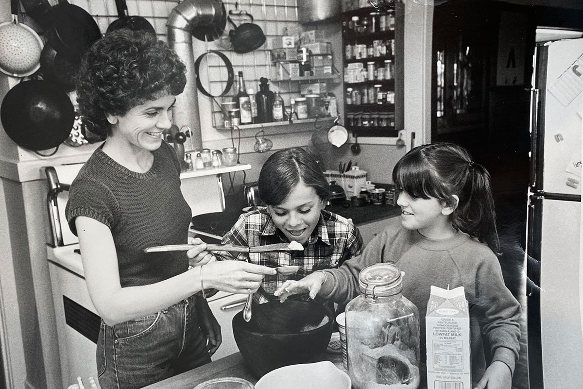 black and white photo of people in a kitchen