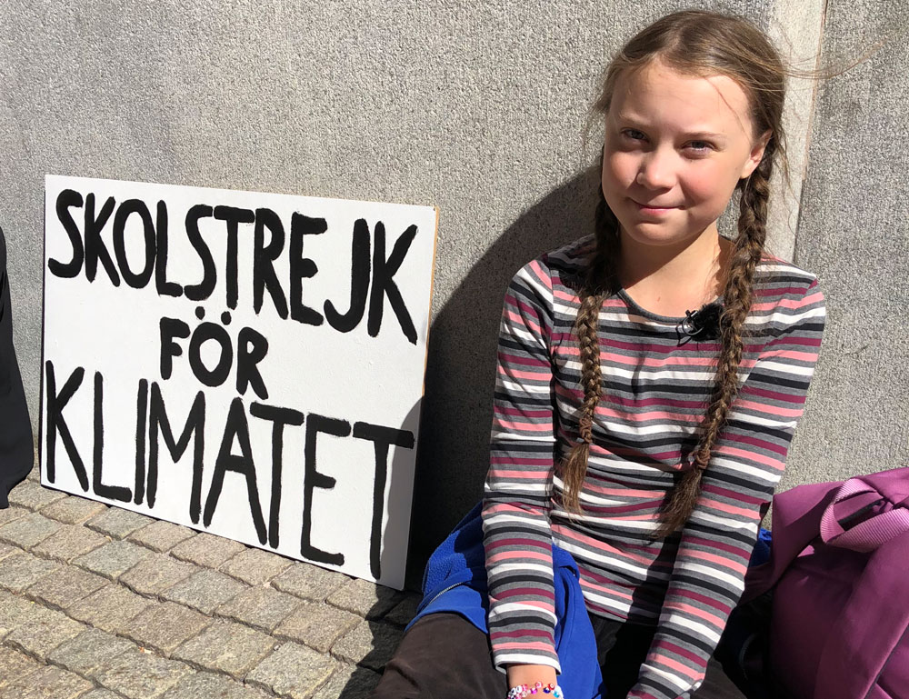 Greta Thunburg at her strike spot in front of the Swedish Parliament