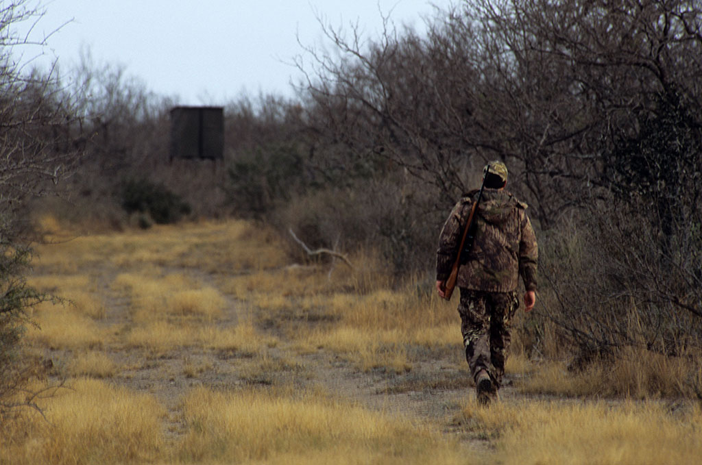 A guide always accompanies the shooter at canned hunting ranches to make sure the client shoots the buck he paid for. In some cases, the guide also fires when the client fires to make sure the deer is hit. Photo by Tosh Brown / ALAMY STOCK photo.