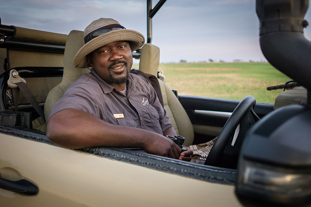 Safari employees like driver Isaac Kalio (pictured) are key to spreading word about the benefits of wildlife conservation among local communities.