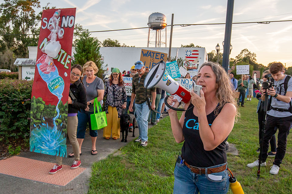 nestle protest.merrillee megaphone In: The River of Discords | Our Santa Fe River, Inc. (OSFR) | Protecting the Santa Fe River in North Florida