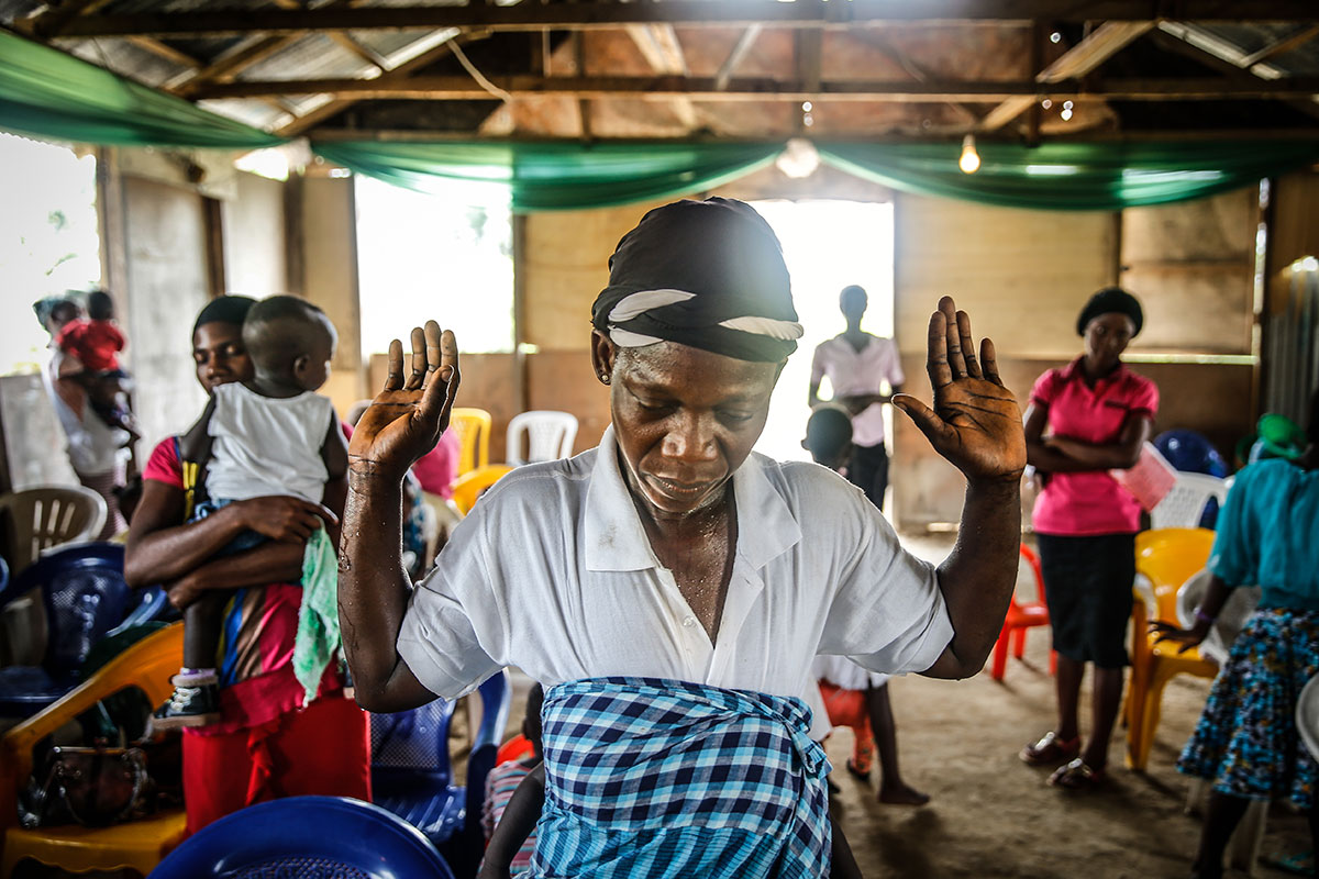 Women at a church service in Oruma village in Ogoniland. A 2017 study found that infants born to women who lived within six miles of oil spills were twice as likely to die early, and the ones who survived were more likely to have impaired health. Photo Milieudefensie / Akintunde Akinleye