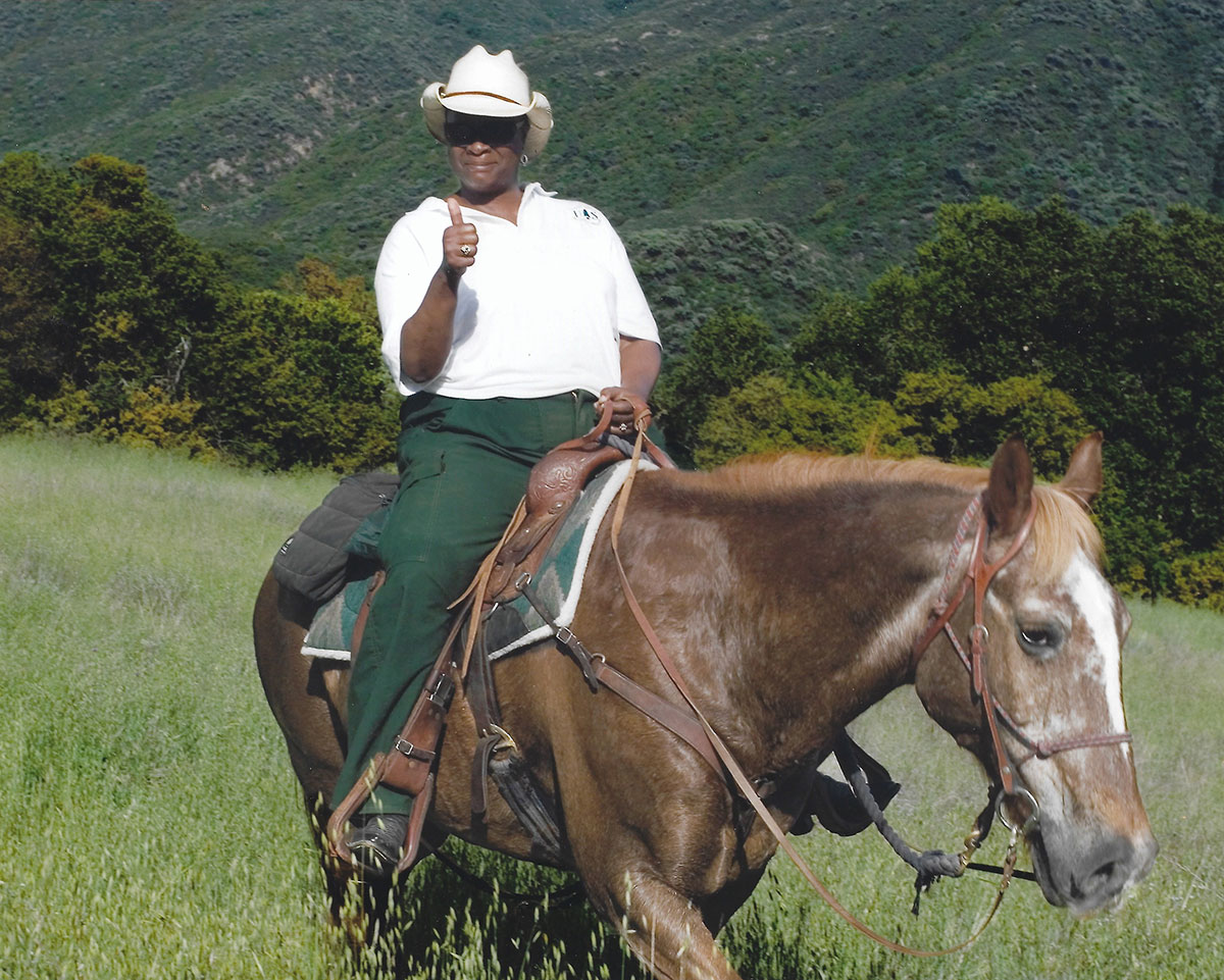 """""""It really takes a certain persona and attitude to want to work in the woods for the Forest Service,"""" says Brown, pictured here in Los Padres National Forest in California. Photo from Black Woman in Green, Courtesy of Oregon State University press."""