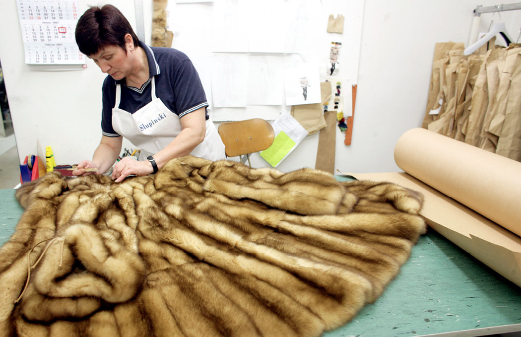 A staff member works on a sable coat at a fur factory in Duesseldorf, Germany. More than a dozen European countries have banned or are phasing out farming of fur. Photo DPA Picture Alliance Archive / Alamy Stock Photo
