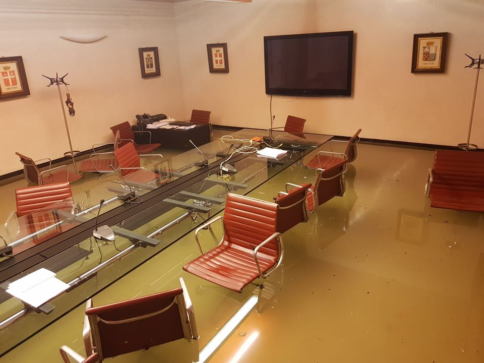 Photos uploaded to Facebook by Andrea Zanoni, deputy chairman of the council for the northeaster region of Vento's environment committee, show the council chambers flooding just minutes after council failed to pass measures to tackle climate change.