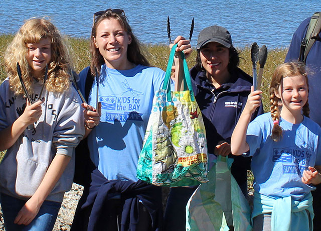 photo of young people doing shore cleanup