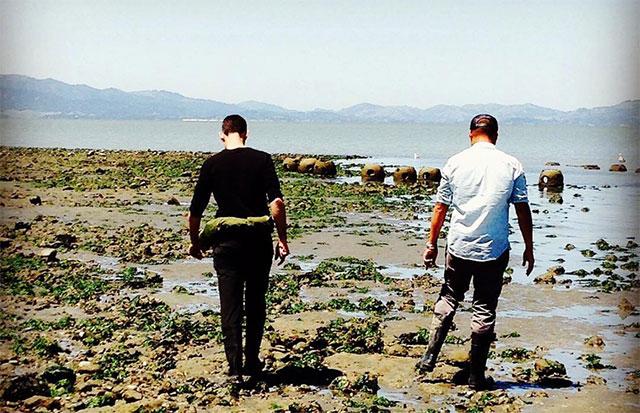 photo of people walking on a tide flat