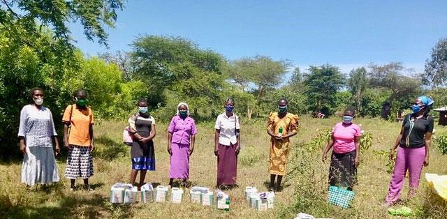 photo of women in a field